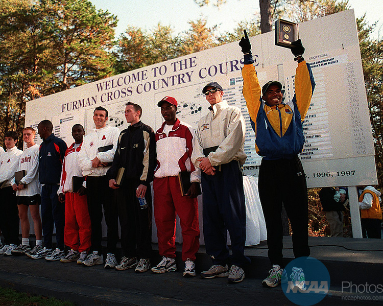 24 NOV 1997: Mebrahtom Keflezighi of UCLA (far right) celebrates his victory with other top finishers at the Division 1 Men's Cross Country Championships at the Furman Cross Country Course at Furman University in Greenville, SC. Keflezighi finished first with a time of 28:54. Thomas McCarver/NCAA Photos.