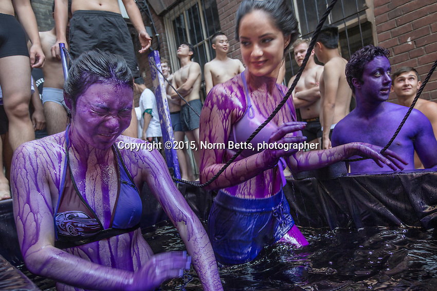 FIRSY DAY AT UNI  - First year students  in The University of Toronto's dept. of engineering traditionally are dyed purple&hellip;. by upper class engineers.... the dye scrubs off in about a week.<br /> First year engineering students, Cynthia Jingi (left) and Olivia Aljoundi, emerge from dunking themselves in a tank of purple dye.<br />  <br /> normbetts@canadianphotographer.com<br /> 416 460 8743