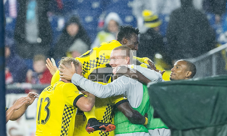 Foxborough, Massachusetts - May 19, 2018:  In a Major League Soccer (MLS) match, Columbus Crew (yellow) defeated New England Revolution (white/red), 1-0, at Gillette Stadium.<br /> Goal celebration.
