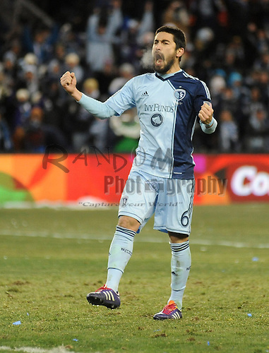 Dec 7, 2013; Kansas City, KS, USA; Sporting KC midfielder Paulo Nagamura (6) celebrates after scoring a goal against the Real Salt Lake during the penalty kick shootout in the 2013 MLS Cup at Sporting Park. Mandatory Credit: Denny Medley-USA TODAY Sports