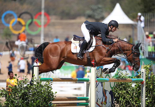 14.08.2016. Rio de Janeiro, Brazil. Eduardo Alvarez Aznar of Spain on horse Rokfeller De Pleville clears an obstacle during the Jumping Team 1st Qualifier of the Equestrian competition at the Olympic Equestrian Centre during the Rio 2016 Olympic Games in Rio de Janeiro, Brazil, 14 August 2016.
