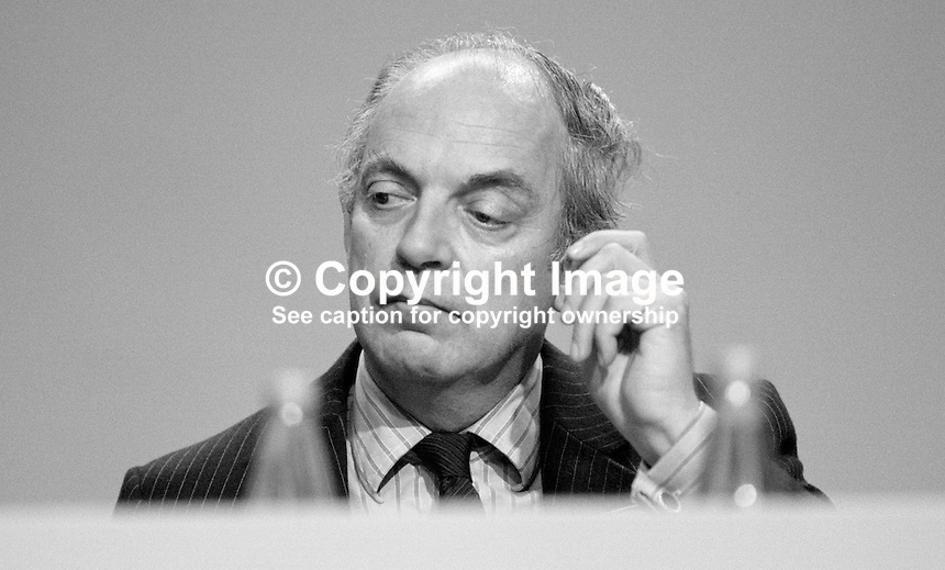 John Biffen, MP, Leader of the House of Commons, Conservative Party, UK, on platform during his party's 1984 annual conference, Brighton, the year the adjacent Grand Hotel, was bombed by the Provisional IRA. The Grand Hotel was where most cabinet members and senior party officials were staying. 19840139JB1.<br />