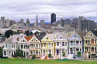 Famous Victorian House row and skyline with Transamerica Building in San Francisco Californi