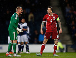 Kasper Schmeichel of Denmark and Daniel Agger of Denmark argue with each other as Scotland celebrate their first goal during the Vauxhall International Challenge Match match at Hampden Park Stadium. Photo credit should read: Simon Bellis/Sportimage