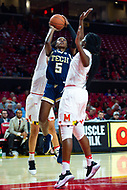 College Park, MD - NOV 29, 2017: Georgia Tech Yellow Jackets guard Elizabeth Balogun (5) splits Maryland defenders on her way to the basket during ACC/Big Ten Challenge game between Gerogia Tech and the No. 7 ranked Maryland Terrapins. Maryland defeated The Yellow Jackets 67-54 at the XFINITY Center in College Park, MD.  (Photo by Phil Peters/Media Images International)