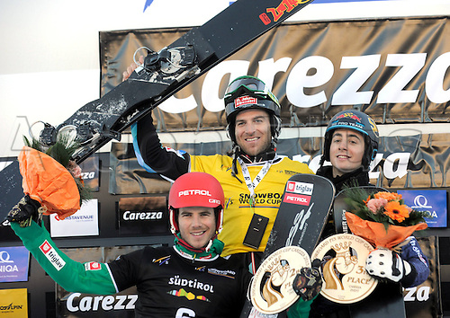 13.12.2013  CAREZZA, ITALY. Mens SNOWBOARD FIS World cup Parallel.  Zan Kosir (SLO), Anton Unterkofler and Lukas Mathies (AUT).