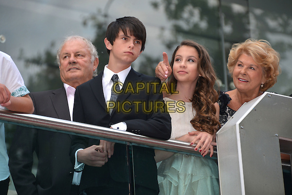 Dylan Douglas and Carys Zeta Douglas, son of Michael Douglas and daughter of Catherine Zeta Jones and Michael, with Catherine's parents Patricia (n&eacute;e Fair), a seamstress, and David Jones<br /> attending Marvel's Ant-Man European film premiere at Odeon cinema, Leicester Square,, London England on July 8th 2015.<br /> CAP/PL<br /> &copy;Phil Loftus/Capital Pictures