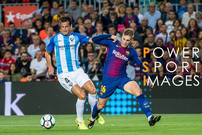 Gerard Deulofeu Lazaro (r) of FC Barcelona battles for the ball with , Luis Hernandez Rodriguez of Malaga CF during the La Liga 2017-18 match between FC Barcelona and Malaga CF at Camp Nou on 21 October 2017 in Barcelona, Spain. Photo by Vicens Gimenez / Power Sport Images