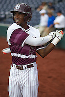 Mississippi State outfielder Demarcus Henderson (2) warms up during batting practice before Game 11 of the 2013 Men's College World Series against the Oregon State Beavers on June 21, 2013 at TD Ameritrade Park in Omaha, Nebraska. The Bulldogs defeated the Beavers 4-1, to reach the CWS Final and eliminating Oregon State from the tournament. (Andrew Woolley/Four Seam Images)