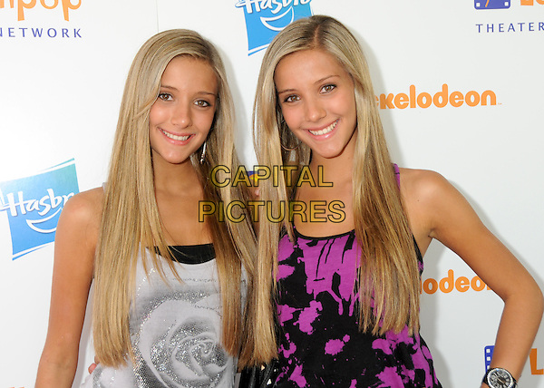 "BECKY ROSSO & MILLY ROSSO.Lollipop Theater Network's 2nd Annual ""Game Day"" held at  Nickelodeon Animation Studios, Burbank, California, USA..May 2nd, 2010.half length jeans denim camilla rebecca twins sisters skirt jean grey gray top pink pattern top sisters siblings.CAP/ADM/BP.©Byron Purvis/AdMedia/Capital Pictures."