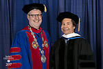 The Rev. Dennis H. Holtschneider, C.M., president of DePaul, left, and commencement speaker and honorary degree recipient Stuart Dybek, poet and fiction writer. DePaul University School for New Learning held its commencement ceremony, Saturday, June 10, 2017, at the Rosemont Theatre in Rosemont, IL. The Rev. Dennis H. Holtschneider, C.M., president of DePaul, conferred the degrees. (DePaul University/Jeff Carrion)