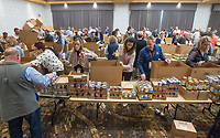 NWA Democrat-Gazette/BEN GOFF @NWABENGOFF<br /> Tyson employees from around the country fill meal boxes Wednesday, Dec. 5, 2018, at Embassy Suites Northwest Arkansas in Rogers. More than 800 Tyson employees from across the country who are in town this week attending the company's annual sales conference took the afternoon to pack and load food donations. The employees helped distribute 35,000 pounds of Tyson products to Northwest Arkansas organizations with feeding services and food banks. In addition 1,000 meal boxes, 15,000 snack packs and personal hygiene kits were packaged and distributed to Northwest Arkansas non-proffits.
