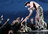 Country music star Tim McGraw shakes the outstretched hands of military and family members at a free concert at Fort Carson, Colorado on May 21, 2003.  He put on the free concert to show appreciation for the military.