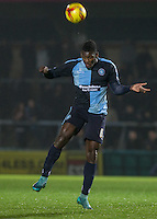 Aaron Pierre of Wycombe Wanderers heads clear during the Sky Bet League 2 match between Wycombe Wanderers and Notts County at Adams Park, High Wycombe, England on 15 December 2015. Photo by Andy Rowland.