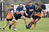 Kieran Whyte charges upfield towards Caleb Brown. Counties Manukau Premier Counties Power Club Rugby Round 2, Game of the Week, between Te Kauwhata and Onewhero, played at Te Kauwhata on Saturday March 17th 2018. <br /> Photo by Richard Spranger.<br /> <br /> Onewhero won the game 43 - 10 after leading 21 - 10 at halftime.<br /> Te Kauwhata EnviroWaste  10 - Lani Latu try,  Caleb Brown 1 conversion, Caleb Brown 1 penalty.<br /> Onewhero 43 - Jackson Orr 2, Ilaisa Koaneti 2, Vaughan Holdt, Zac Wootten, Rhain Strang tries, Vaughan Holdt 4 conversions.