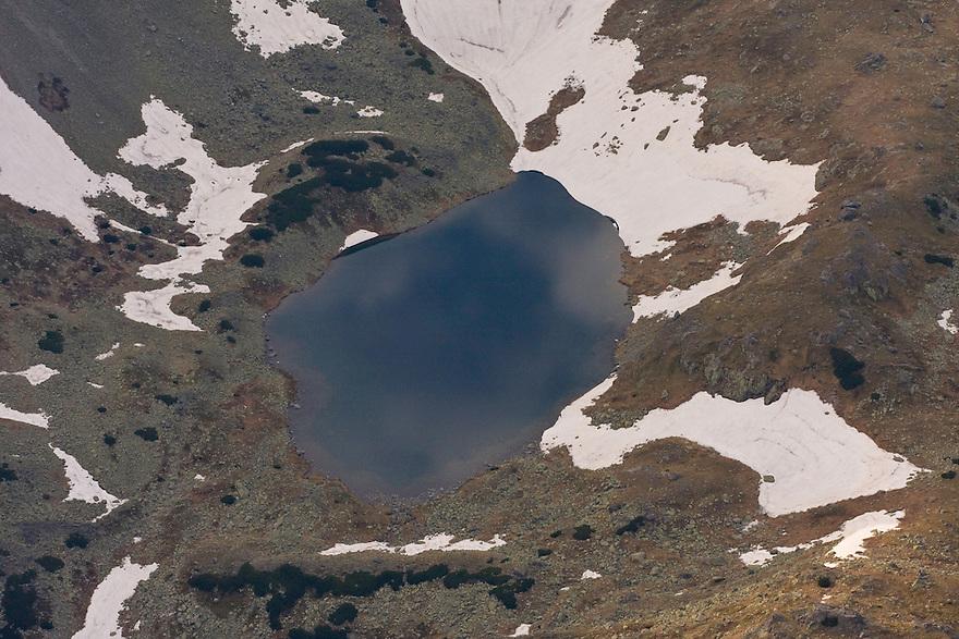 Alpine lake created by melting snow. High Tatras, Slovakia. June 2009. Mission: Ticha