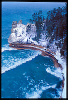 MINER'S CASTLE ROCK FORMATION AT PICTURED ROCKS NATIONAL LAKESHORE NEAR MUNISING MICHIGAN DURING A WINTER SNOW STORM.