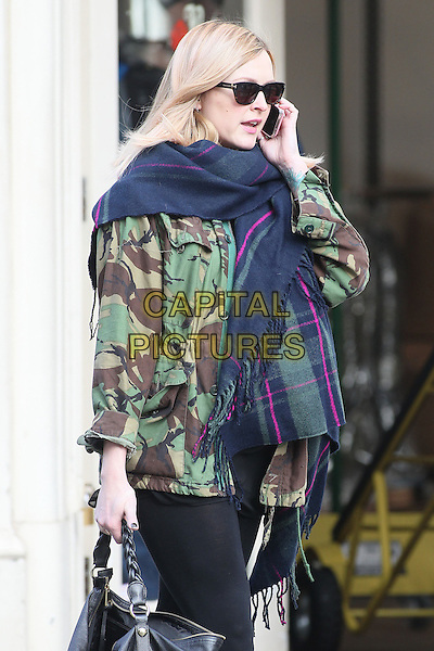 Fearne Cotton.Seen leaving work after her morning radio show, BBC Radio 1 studios, London, England, UK, .23rd November 20212..half length sunglasses pregnant black leggings camouflage jacket green army tartan plaid navy blue scarf black talking on mobile phone.CAP/HIL.©John Hillcoat/Capital Pictures.