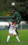 13 September 2009: University of Vermont Catamount forward D.J. Edler, a Freshman from Atlanta, GA, jumps over University of Massachusetts Minutemen midfielder Dominic Skrajewski, a Freshman from Downingtown, PA, during the second round of the 2009 Morgan Stanley Smith Barney Soccer Classic held at Centennial Field in Burlington, Vermont. The Catamounts and Minutemen battled to a 1-1 double-overtime tie. Mandatory Photo Credit: Ed Wolfstein Photo