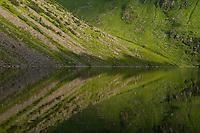 Mountain reflection in lake Utdalsvatnet, Unstad, Vestvågøy, Lofoten Islands, Norway