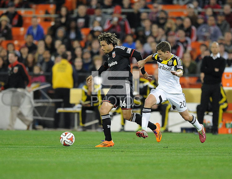Washington D.C. - March 8, 2014: Nick DeLeon (14) of D.C. United goes against Wil Trapp (20) of the Columbus Crew.   The Columbus Crew defeated D.C. United 3-0 during the opening game of the 2014 season at RFK Stadium.