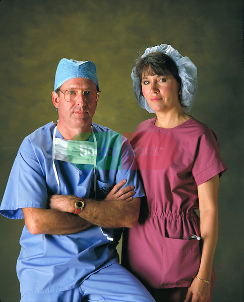 portrait of male doctor and female nurse in uniform