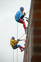 NWA Democrat-Gazette/BEN GOFF @NWABENGOFF<br /> Ryan Love (bottom), a Sunshine School and Development Center adult client from Rogers, and Nicky Dou of Bentonville rappel wearing superhero outfits Saturday, March 11, 2017, during the Sunshine School &amp; Development Center's rappelling fundraiser with Over The Edge at the 8W Center in Bentonville. The school began a campaign in January, with participants who reached their fundraising goal able to participate in rappelling from the roof of the 6-story building. Over the Edge is a company which specializes in producing events for non profits using equipment and techniques used in commercial rope-access work such as sign installation and window washing. The event had raised more than $57,000 for the school, with more donations still coming in Saturday morning. Located in Rogers, the Sunshine School &amp; Development Center serves children and adults with developmental dissabilities, including a preschool.
