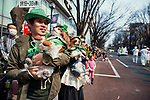 Dogs and their owners watch the 25th Annual St. Patrick's Day Parade on Sunday, March 19, 2017 in Tokyo, Japan.<br /> Photo by Kevin Clifford