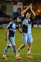 Sam Wood of Wycombe Wanderers (left) and Garry Thompson of Wycombe Wanderers after the Sky Bet League 2 match between Luton Town and Wycombe Wanderers at Kenilworth Road, Luton, England on 26 December 2015. Photo by David Horn.