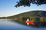 Woman canoeing on North Pond, Woodstock, Maine, USA