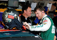 Nov. 13, 2009; Avondale, AZ, USA; NASCAR Sprint Cup Series driver Dale Earnhardt Jr with crew chief Lance McGrew during practice for the Checker O'Reilly Auto Parts 500 at Phoenix International Raceway. Mandatory Credit: Mark J. Rebilas-
