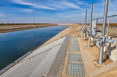 The California Aqueduct is a 444 mile canal, part of the California State Water Project, that carries water from Northern California to Southern California, San Joaquin Valley, Mendota, Fresno County California, USA