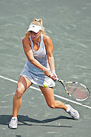 April 11, 2010:  MPS Group Championships.  Caroline Wozniacki (DEN) returns a backhand to Olga Govortsova (BLR) (not pictured) during finals singles action at the MPS Group Championships played at the Sawgrass Country Club in Ponte Vedra, Florida.  Caroline Wozniacki (DEN) defeated Olga Govortsova (BLR) 6-2, 7-5 to win the tournament for the second consecutive year..