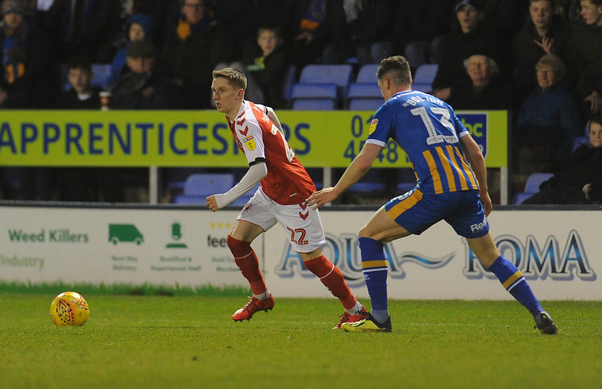 Fleetwood Town's Ashley Hunter under pressure from Shrewsbury Town's James Bolton<br /> <br /> Photographer Kevin Barnes/CameraSport<br /> <br /> The EFL Sky Bet League One - Shrewsbury Town v Fleetwood Town - Tuesday 1st January 2019 - New Meadow - Shrewsbury<br /> <br /> World Copyright © 2019 CameraSport. All rights reserved. 43 Linden Ave. Countesthorpe. Leicester. England. LE8 5PG - Tel: +44 (0) 116 277 4147 - admin@camerasport.com - www.camerasport.com