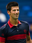 SHANGHAI, CHINA - OCTOBER 15:  Novak Djokovic of Serbia smiles during his match against Guillermo Garcia-Lopez of Spain during day five of the 2010 Shanghai Rolex Masters at the Shanghai Qi Zhong Tennis Center on October 15, 2010 in Shanghai, China.  (Photo by Victor Fraile/The Power of Sport Images) *** Local Caption *** Novak Djokovic