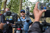 Muslim preacher, Speakers' Corner, Hyde Park, London, where the use of video cameras and smartphones to record speakers, preachers, sermons and arguments, for broadcast via social media, has become widespread in recent months.