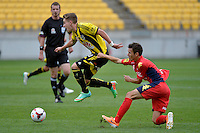 Tyler Boyd and Isaias during the A League - Wellington Phoenix v Adelaide United, Wellington, New Zealand on Sunday 30 March 2014. <br /> Photo by Masanori Udagawa. <br /> www.photowellington.photoshelter.com.