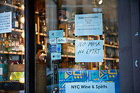 New York, New York City in the time of Coronavirus. No Mask no entry sign at the local liquor store.