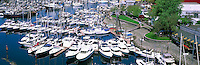 Motorboats, Yachts, and Sailboats docked at Granville Island Marina in False Creek, Vancouver, BC, British Columbia, Canada - Panoramic View