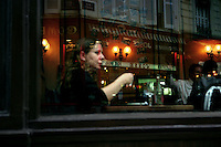 Girl in the window of a bistro, Montmartre, Paris, France, 17 September 2009