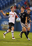 HOOVER, AL - DECEMBER 07, 2012:  Jereme Raley (12) of the University of Maryland goes for the ball with Andy Riemer (20)of Georgetown University during an NCAA 2012 Men's College Cup semi-final match, at Regions Park, in Hoover , AL, on Friday, December 07, 2012. The game ended in a 4-4 tie, Georgetown won on penalty kicks after overtime.