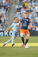 Gaetan Charbonnier (9) forward Montpellier holds off KC defender..Sporting Kansas City were defeated 3-0 by Montpellier HSC in an international friendly at LIVESTRONG Sporting Park, Kansas City, KS...
