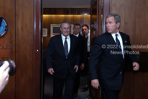 United States President George W. Bush departs US Secretary of Defense Donald H. Rumsfeld's office after meetings in the Pentagon on May 10, 2004.  Bush and his national security team met for a briefing from senior Department of Defense (DoD) officials and military commanders in the field via video teleconferencing.  <br /> Mandatory Credit: Jerry Morrison / DoD via CNP