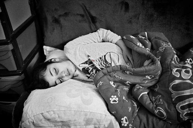 25..3.2015 Kirkuk,Iraq. Marta usually takes a nap for 2-3 hours after coming back from the school.