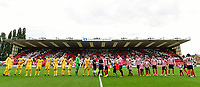 The Morecambe and Lincoln City teams line up in front of a background of a display by Lincoln City fans in the Lincolnshire Co-operative Stand<br /> <br /> Photographer Chris Vaughan/CameraSport<br /> <br /> The EFL Sky Bet League Two - Lincoln City v Morecambe - Saturday August 12th 2017 - Sincil Bank - Lincoln<br /> <br /> World Copyright &copy; 2017 CameraSport. All rights reserved. 43 Linden Ave. Countesthorpe. Leicester. England. LE8 5PG - Tel: +44 (0) 116 277 4147 - admin@camerasport.com - www.camerasport.com