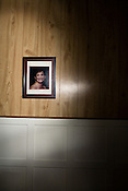 March 12, 2009. Rocky Mount, NC.<br />  A photo of Pam on the wall of the living room in the home she shared with June.<br />  Juneann Tesarz Galbraith lost her partner, Pam, in January 2009. Due to the fact that they could not be legally married or considered civil partners under NC law, June has had to deal with the ordeal much on her own.. June is also currently unemployed and was living off the disability payments that Pam received while still alive. She is in danger of losing her home if she does not find a job soon, but living in a town with an estimated 12% her chances are diminished..