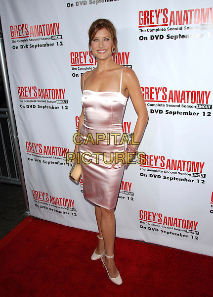 KATE WALSH.The Grey's Anatomy 2nd Season DVD Launch held at Social in Hollywood, California, USA..September 5th, 2006.Ref: DVS.full length pink satin dress hand on hip gold clutch purse bracelet.www.capitalpictures.com.sales@capitalpictures.com.©Debbie VanStory/Capital Pictures