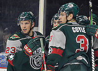 Houston Aeros players Steven Kampfer (23) and Charlie Coyle (3) celebrate a goal with teammates during an AHL hockey game against the San Antonio Rampage, Sunday, Oct. 14, 2012, in San Antonio. San Antonio won 3-2. (Darren Abate/pressphotointl.com)