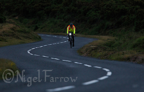 10 JUN 2011 - BRANSGORE, GBR - Carl Atkinson makes his way along the bike course at dusk during the Triple Enduroman at the Enduroman Ultra Triathlon Championships .(PHOTO (C) NIGEL FARROW)