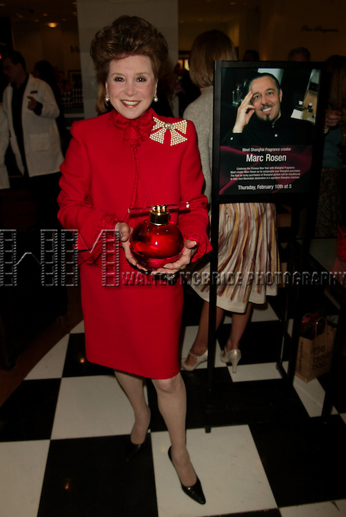 Cindy Adams helps celebrate the Chinese New Year with the launch of Shanghai Fragrance at Bloomingdale's Fragrances on the B'way in New York City. While the creator Marc Rosen signs bottles for customers, An 8 foot-long Chinese Dragon marches through out the Store and a Rickshaw service awaits outside the lobby doors..( seen here tryng to fix her broken pocketbook ).February 10, 2005.© Walter McBride